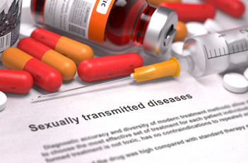 Sexually transmitted diseases-printed diagnosis with red Pills, injections and syringe
