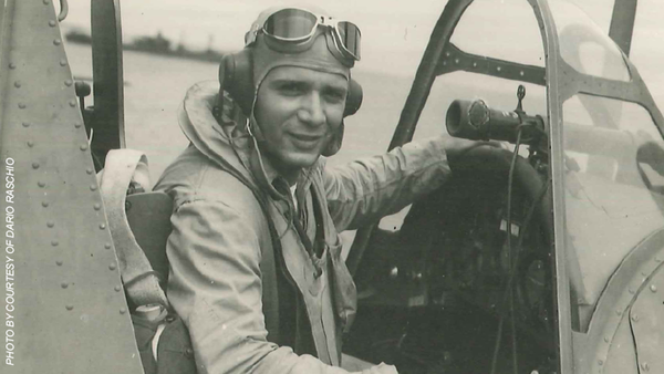 Lt. Dario Raschio sits in the cockpit of his Navy OS2-U Kingfisher observation floatplane during WW II in the south Pacific.