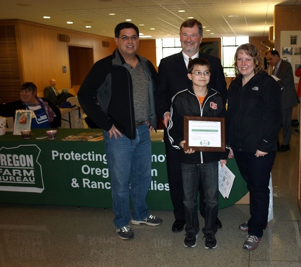 Presentation of award to Nathan Barnes, winner of Oregon Farm Bureau's