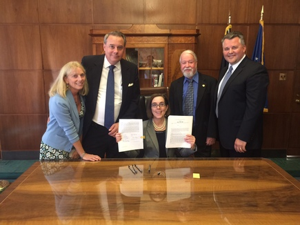 HB 3099 Signing Ceremony -- Sen. Riley with Governor Brown and three other attendees