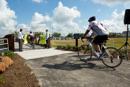 Riders Cross the Jackie Freeman bike bridge at the Kingsland Park&Ride
