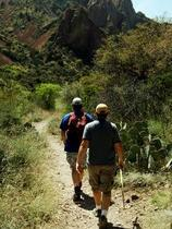 two hikers on a trail