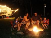 family around campfire