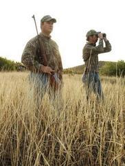 two hunters in field