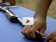 shotgun being cleaned