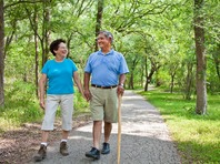 couple walking on shaded trail