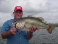 angler Gary Wingate holding 13 lb + bass