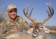 Winner Stephen Poskey with his Whitetail