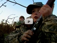 two youths close up in camo
