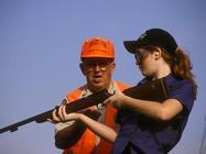 instructor, female student, rifle