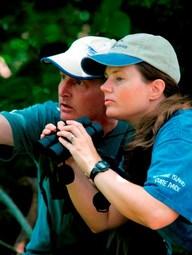 two birders staring intently, 1 with binoculars