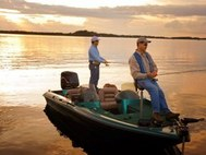 2 men, bass boat, fishing on lake
