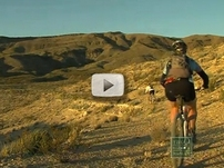 rugged terrain, desert, 2 biker riding away