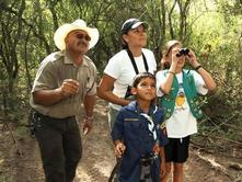park ranger, 2 kids,1 adult scouting birds