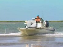boat, motor cruising in shallow coastal water