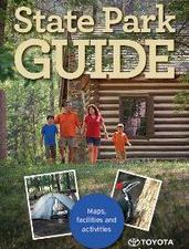 State Park Guide cover, family walking near woodsy cabin