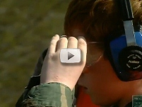 young hunter in ear protection,safety glasses