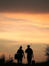 sillouette 2 dove hunters walking with gear