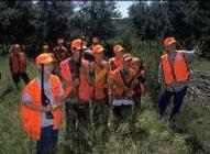 young hunters with instructor in field