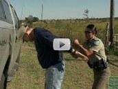 warden cuffs a suspect