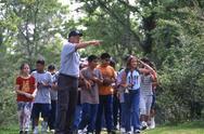 volunteer leads group of kids on walk