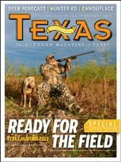 Magazine cover man in camo with rifle in woods