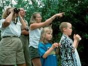 family looking through binoculars