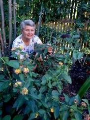 smiling woman with lantana plant