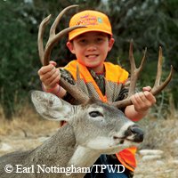 young hunter with buck