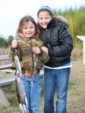 2 girls with string of trout