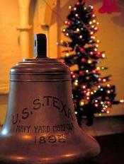 Ship's bell in front of Christmas tree