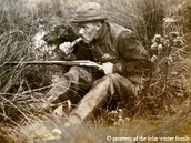 old photo: single hunter,gun,duck call