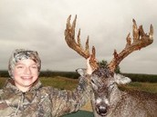 young man with trophy buck
