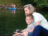 mother and very happy child fishing