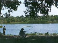 man and woman bank fishing, Brazos Bend