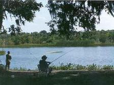 man and woman bank fishing, Brazos Bend