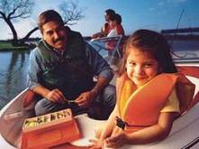 family wearing life vests in boat