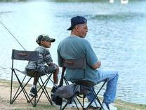 boy and older man in chairs, fishing