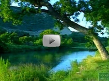 S. Llano River flowing through green grasses