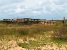 boardwalk through beach grasses, Gulf in background