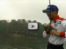 angler fishing in tournament on lake