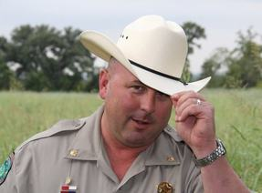 Game Warden tips his hat