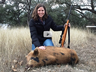 Female hunter with feral hog