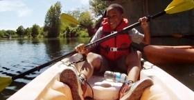 child paddling kayak