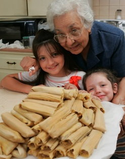 family with platter of tamales