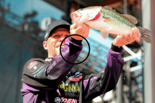 BassMaster Fest contestant holding bass, video link