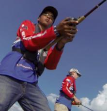two high school boys fishing