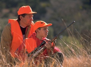 father and son wearing blaze orange while hunting