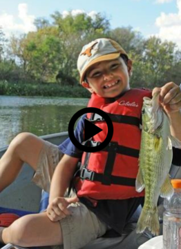 happy boy holding up Guadalupe bass, video link