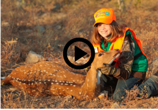girl in hunter orange with doe she harvested, play button